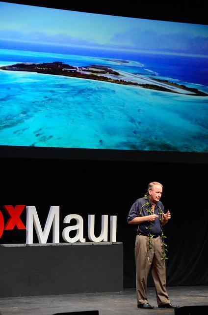 Byron Washom speaking on stage at TEDxMaui 2012